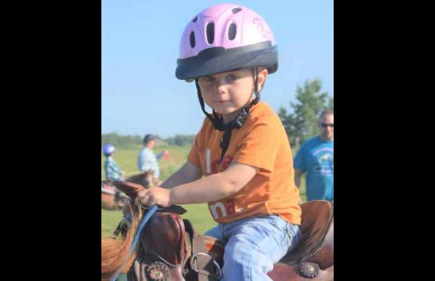 NEVER TOO YOUNG TO GET ON A HORSE!